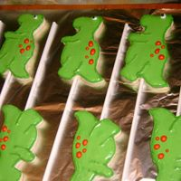 T-Rex Cookie Pops These went with a T-Rex cake for a 5th birthday. They are NFSC iced in royal.
