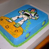 Buzz Lightyear This was for a 4 year old's birthday. It is a funfetti cake fill with chocolate buttercream. It is iced in BC. The Buzz design is made...