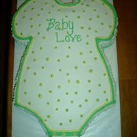 Baby Onesie This was my first attempt at a baby onesie. It is half chocolate, half yellow cake as requested. It is iced in BC.