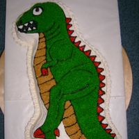T-Rex Birthday Cake This was for a 5 year old's birthday. It's iced in BC and is a chocolate cake. I used the partysaurus pan from Wilton that is...
