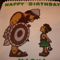 David And Goliath B-Day Cake  This was my first try at a chocolate transfer and I have to admit that I'm pretty pleased with the results! Simple yellow cake w/...