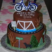 "Bicycling Themed Cake For A 50Th Birthday 6"" and 9"" tiers, chocolate buttercream with fondant accents and handpainted gumpaste bicycle topper. The street signs are names..."