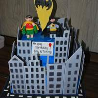 Batman And Robin Cityscape Batman and Robin and Gothan city for my sons' 5th birthday. Fondant buildings & figures and bat signal.