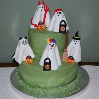 Trick Or Treating Ghosts Trick or Treating fondant ghosts on buttercream cake. Inspired by Shelly150 and other cakes on CC. The ghosts turned out to be a little too...