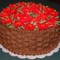 "Poinsettia Basket Chocolate buttercream basketweave with buttercream poinsettias. 8"" cake."