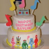 Yo Gabba Gabba Cake Yo Gabba Gabba Cake for 2nd birthday. BC with fondant characters, lettering, notes and radio topper, BC ball border. Foofa (the pink one)...