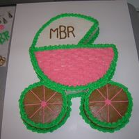 Baby Shower Cake   12 inch round with two 6 inch rounds for a baby carriage.