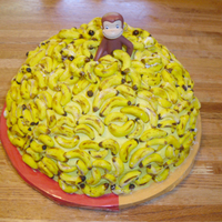 Curious George Birthday Cake this is the cake i made for my twin's 4th birthday party tomorrow. it's a chocolate chip cake with buttercream frosting and 255...