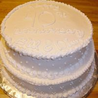 40Th Anniversary Cake this is a strawberry cheesecake cake, filled with cream cheese filling and frosted with mary kay frosting. it's ivory frosting with...