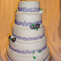 Purple And White Wedding Cake this is my first wedding cake! it's marble cake, filled with purple buttercream, frosted with buttercream and covered in fondant,...