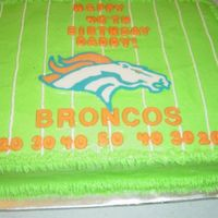 Broncos Cake I saw this on here, thank you to whomever you are, sorry I cant remember! It was half choc, half yellow, buttercream frosting with candy...