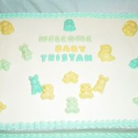 Baby Shower Yellow cake frosted in buttercream with candy melt mold decorations.