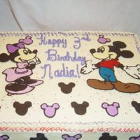 Mickey And Minnie Mouse This was a cake I made for my niece in June. Its half choc half yellow with candy melt decorations.