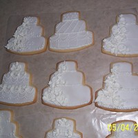 Wedding Cake Cookies...practice  Freehanded wedding cake cookies. I've always wanted to do some of these so this is my first try. Some I like better than others, some...