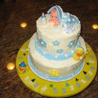 Crawling Baby   This cake was inspired by cakesbydeanna! Simple to make. I loved doing it and the mother to be was thrilled. Thanks for looking!