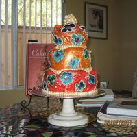 Img_1356.jpg This cake is covered in white fondant, I drew the flowers on and handpainted the entire cake. I thought it looked great. Thanks for looking...