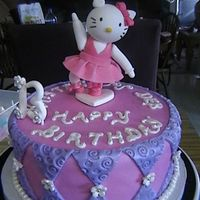 Hello Kitty   Fondant covered white chocolate w/ fudge swirl cake, strawberry filling. Topper and numbers are gumpaste.