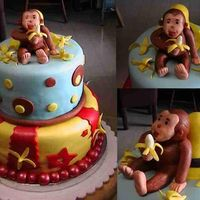 Curious George   Fun cake! All mmf and w/ some gumpaste for the monkey and bananas.