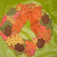 Fall Cookie Wreath Colored NFSC with fondant bow. It's held together by royal icing. Inspired by a picture seen on this site - sorry! I don't...