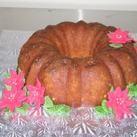Poinsettia Rum Cake I was looking for an easy way to dress up a rum cake and had some poinsettias l had left over from showing a friend how to make them. This...