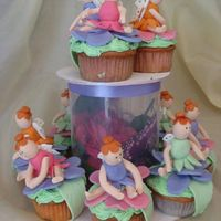 Cupcake Fairies strawberry cupcakes with mmf fairies..... used differnt gumpaste cutters for most parts of the faires like the wings, hair , skirts