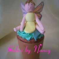 Fairy Cupcake   fairy cupcake in a mini terra cotta flower pot with mmf accents and wafer paper wings.........
