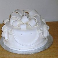 Resized_Elegant_Cake_4.jpg   This is cake #4 for me. Just a practice cake. First time making a fondant bow. It should have been fuller but I ran out of fondant.