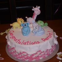 Baby Shower Cake First time doing animals out of fondant. Animals based on the invite, the cake is supposed to reflect a little girl's bed. Fondant &...
