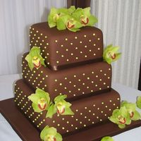 Brown & Green Covered in chocolate fondant w/green pearls and fresh orchids. TFL!