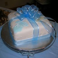 Blue Onesie Baby Shower Cake... This was a baby shower cake for a little boy. It is MMF fondant with MMF decorations and royal icing swiss dots. The ribbon is silk because...