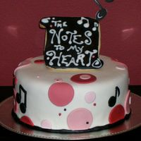 "Musical Notes Couple Shower Cake...  This cake was for a couples shower for a talented and somewhat funky musician. The theme was ""The Notes to My Heart."" The topper..."