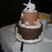 "Seashell Or Beach Shower Cake...  This cake was for a classy bridal shower. The shells are gumpaste or molded white chocolate. The ""sand"" is organic (not raw, but..."
