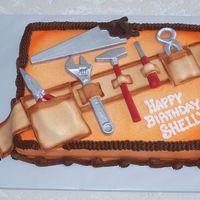 "Tool Belt Cake I was dying to make this cake. The ""tools"" are chocolate and the ""tool belt"" is fondant. I airbrushed ""Home Depot&..."