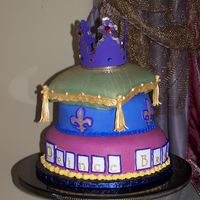 "100_5318.jpg This was my first attempt at a ""Pillow"" cake. Thanks pyxxydust for your help! I tried making the crown out of fondant (didn'..."