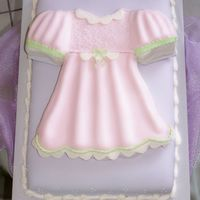 Baby Doll Dress Baby Shower Cake This cake was done using a t-shirt pan and modifying it . It is all fondant .
