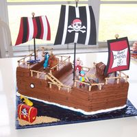 Pirate Ship Birthday Cake This cake was a blast to make!! I was a little intimidated at first, as it looks a little tricky...it was a breeze! I had a cross cake to...