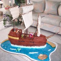 Peter Pan Pirate Ship This cake was done as a dummy....to be looked at by the party goers. The ship was carved by a professional styro carver and then the rest (...