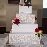 Fondant Wedding With Scroll Work And Draping cake covered in fondant, scroll work in buttercream, draping done with new mold from first impressions, this mold was a huge time saver