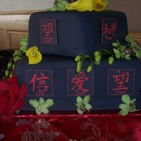 Asian Wedding Cake Design black fondant with run sugar plaques depicting symbols of love, hope...