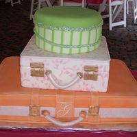 Suitcase Wedding Cake all decorations done in fondant including handles, buckles and roping. Monogram piped with royal, used mat to do design on middle tier