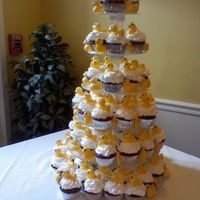 Chocolate Rubber Duckie Cupcake Tower! Red Velvet cupcakes topped with buttercream icing and molded chocolate rubber duckies.