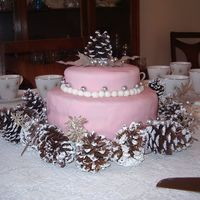Simple Wedding Celebration Cake Round fondant covered wedding cake with pinecone and synthetic leaf accents