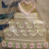Wc1.jpg I made 30 of these sugar cookies for a wedding shower using royal icing.