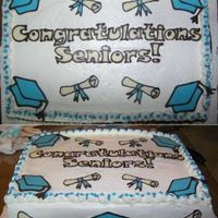 Grad Cake I made the same chocolate decorations as another grad cake on the site. I individually placed jimmies and sprinkles on each shell of the...