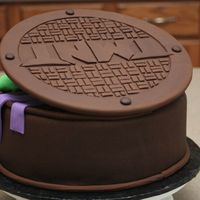 Ninja Turtle-Back Back of the Ninja Turtle Cake. Manhole cover is made of fondant.