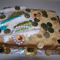 Treasure Map Birthday Cake This cake was made for an 8 year old boy. Yellow cake, torted, with peach jam and dulce de leche filling. Map and pearls were made of...