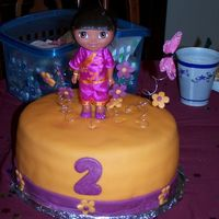 Dora, World Traveler Birthday cake for a 2 year old girl. Yellow cake filled with guava and covered with fondant. Tried to match the color of the fondant with...