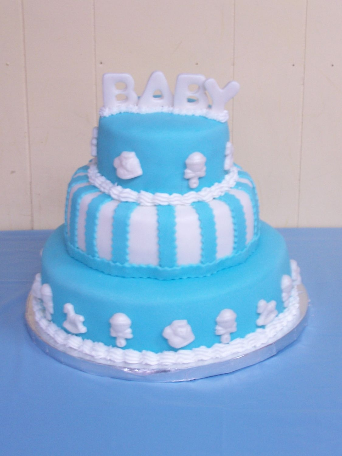Baby Shower Cake Made this for my DH's niece. French vanilla with lemon curd and raspberry filling covered with fondant. All the decorations are also...