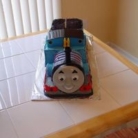 Thomas The Train Birthday Cake   Cake for my son's 3rd birthday. He is a huge Thomas fan. Thomas engine with coal car behind.