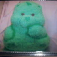 Care Bear  This was my 2nd attempt at a 3D cake. But my husband was so curious, I gave him a 5 minute demonstration and HE did 90% of the light green...